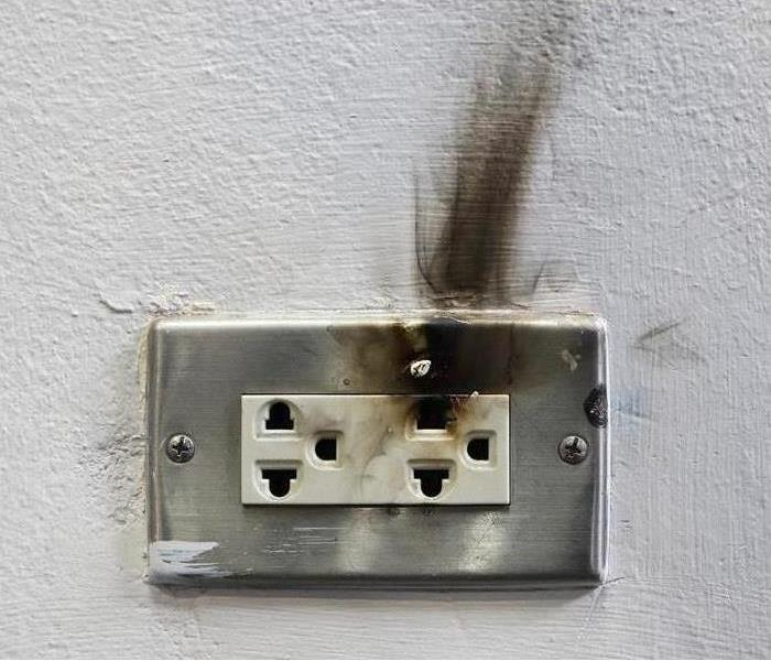 electrical outlet with soot