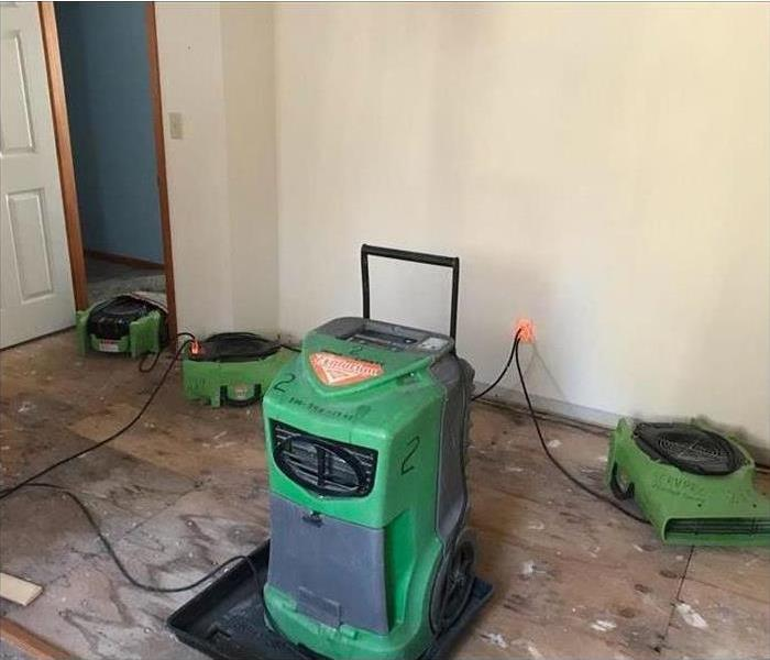 green dehumidifier in a room